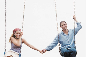 happy couple swinging